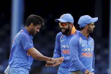Team India celebrates a wicket against West...