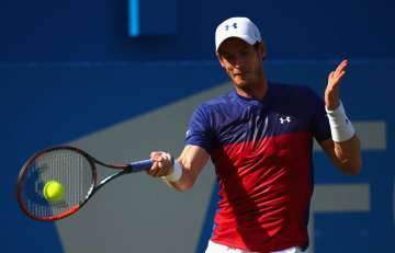 Andy Murray of Great Britain plays a forehand...