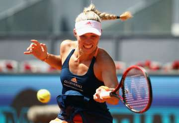 Angelique Kerber of Germany plays a forehand in...