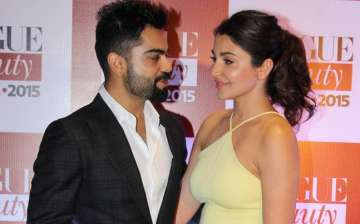 A file image of Virat Kohli and Anushka Sharma. -...