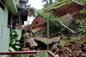 a house damaged due to a landslide triggered by...