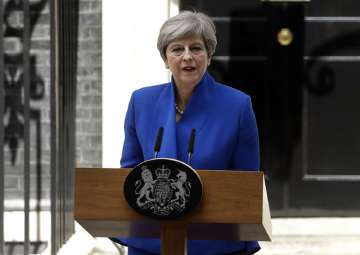 Theresa May addresses the press in Downing...