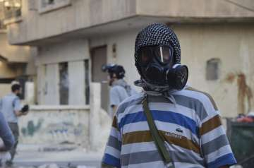 Assad may be preparing chemical weapons attack,...