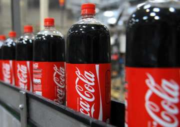 Aerated drinks like Coke will be taxed at 40 per...