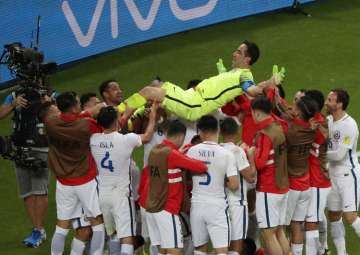 Chile players celebrate their win against...