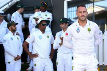 Faf du Plessis of South Africa looks on during...