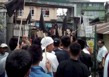GJM supporters waving black flags on the streets...