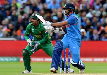 Dhawan plays a shot during ICC Champions Trophy...