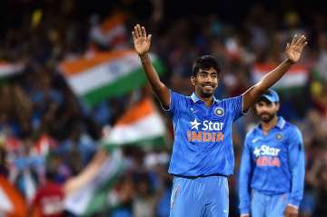 Jasprit Bumrah of India reacts after taking the...