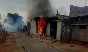 Man thrashed, house set on fire by mob on...