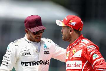 Lewis Hamilton of Great Britain talks with...