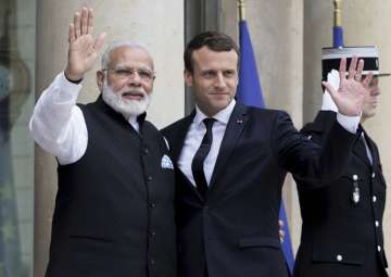 Macron welcomes PM Modi at Elysee Palace in Paris...