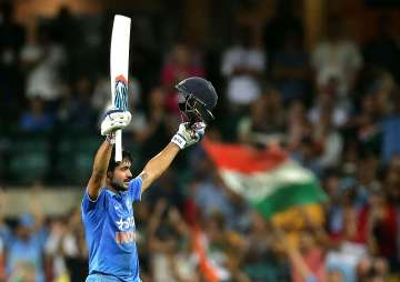 Manish Pandey of India celebrates and...