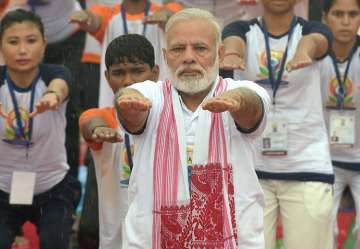 Modi performs yoga along with thousands of others...