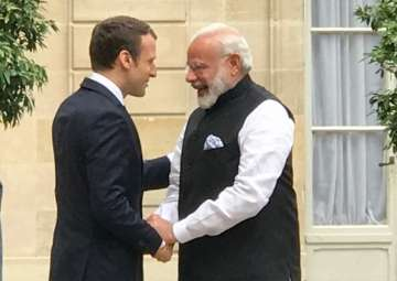 PM Modi meets French President Emmanuel Macron in...