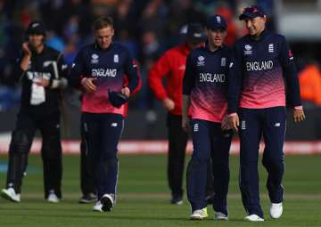 Eoin Morgan speaks to Joe Root during England's...