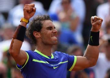 Rafael Nadal reacts after winning the French Open...