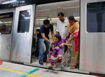 Differently abled passenger being helped during...