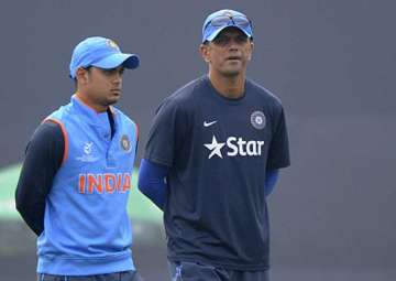 Ishan Kishan of India walks with coach Rahul...