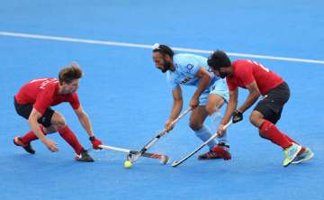 Sardar Singh of India battles for possession with...