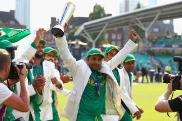 Sarfraz Ahmed lifts the winner's trophy as...