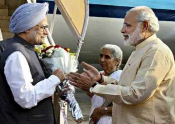 File pic. Former PM Manmohan Singh with his...