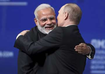 Putin and Modi give each other a hug at SPIEF -...