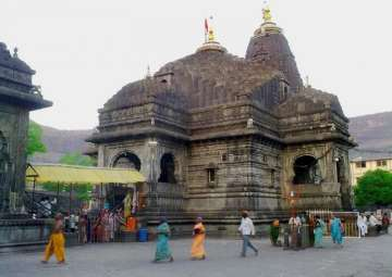 Now offer flowers to Lord Shiva at Trimbakeshwar...