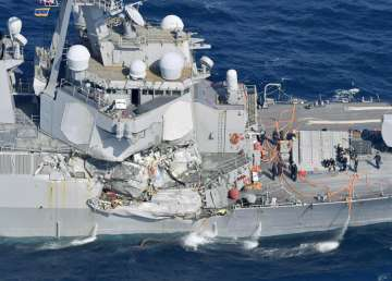 Bodies of missing sailors found on damaged USS...
