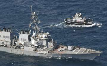 US Navy ship damaged in collision with container...