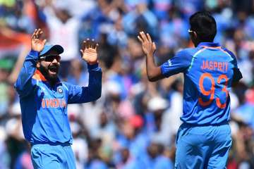 Virat Kohli celebrates with Jasprit Bumrah -...