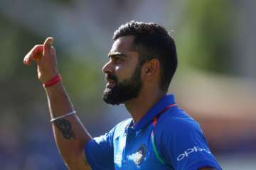 Virat Kohli of India celebrates as he leaves the...