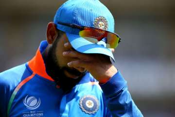 Virat Kohli of India looks on dejected during the...