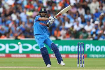 Virat Kohli of India pulls a delivery to the...
