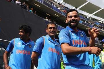 Virat Kohli (R) alongside MS Dhoni (C) and...