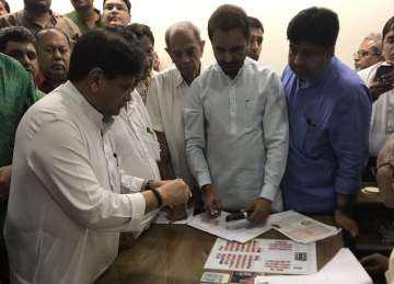 Congress confident of Ahmed Patel's victory in...