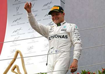 Valterri Bottas reacts after winning the Austrian...