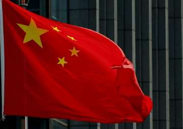 China defends imports of North Korean iron ore -...