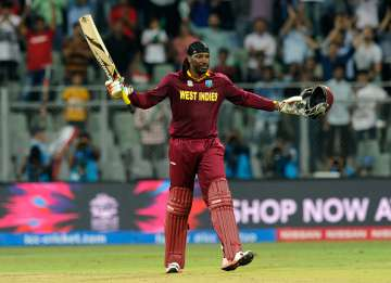 Chris Gayle of the West Indies celebrates his...