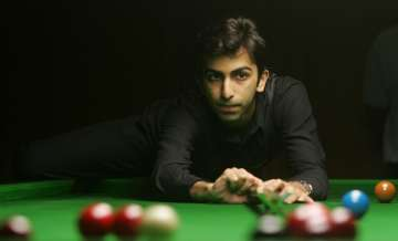 Cueist Pankaj Advani takes aim during his final...