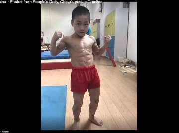 7 year old china boy with 8 pack abs