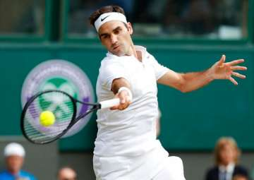 Roger Federer in action in Wimbledon 2017. -...