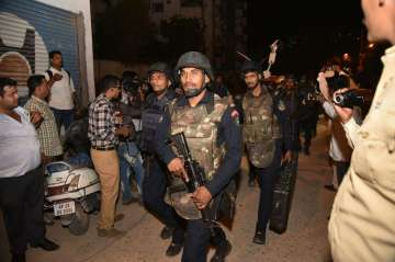 Commandos search for suspects at Hyderabad...