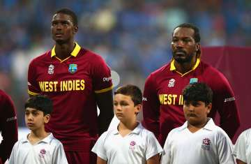 Jason Holder and Chris Gayle of the West Indies...
