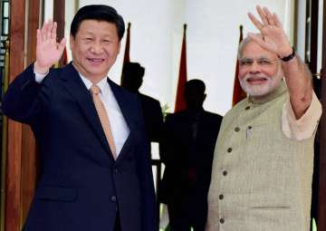 File pic - Xi Jinping and PM Narendra Modi -...