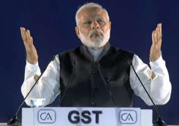 PM Modi addresses ICAI event post GST launch -...