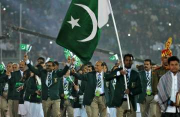 Pakistan athletes march during the opening...