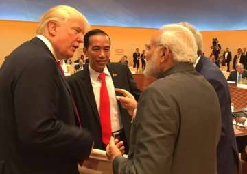 Trump walks up to Modi for 'impromptu' chat at...