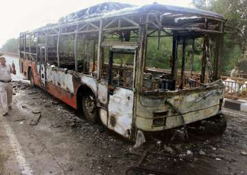New Delhi: A DTC bus set on fire by followers...