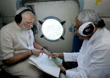 PM Modi conducts aerial survey of flood-hit...